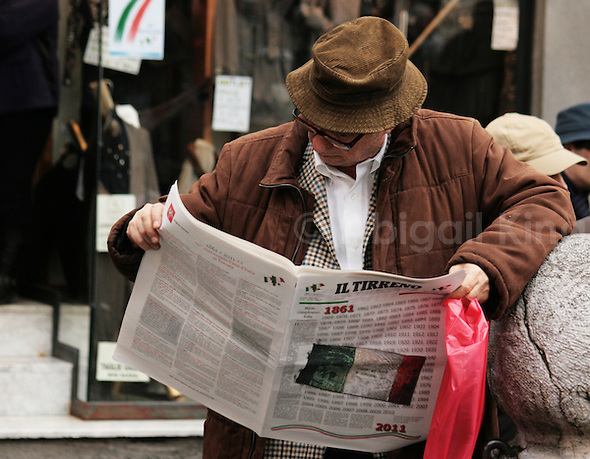 Photos of Italy celebrating its 150th birthday - man reads newspaper