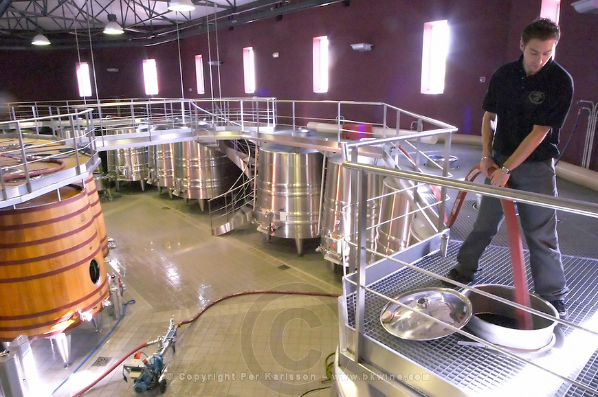 Winery: pumping over, remontage - stock photo samples