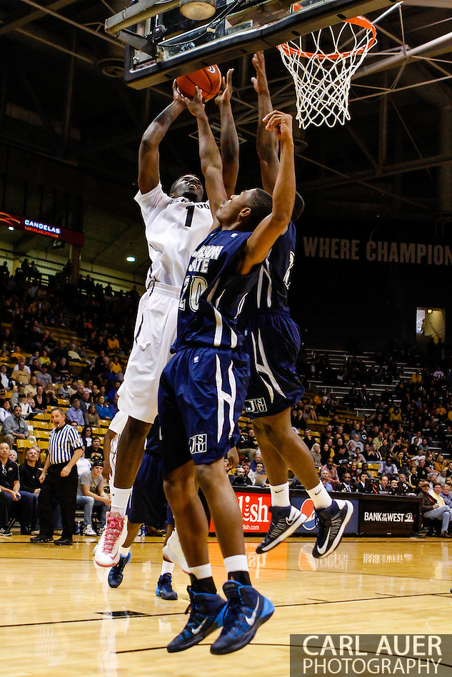 November 16th, 2013:  Colorado Buffaloes redshirt freshman forward Wesley Gordon (1) attempts a shot over Jackson State Tigers freshman guard  Javeres Brent (20) in the first half of the NCAA Basketball game between the Jackson State Tigers and the University of Colorado Buffaloes at the Coors Events Center in Boulder, Colorado (Carl Auer/ZUMAPRESS.com)