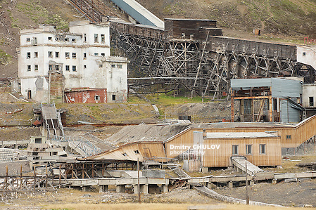 LONGYEARBYEN, NORWAY - SEPTEMBER 03, 2011: Exterior of the ruined coal mine in the abandoned Russian arctic settlement Pyramiden, Norway. (Dmitry Chulov)