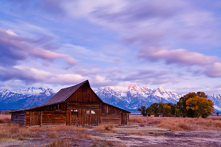Purple and blue light colors the sky over the Moulton barn in Grand Teton National Park. (Benjamin Chase)