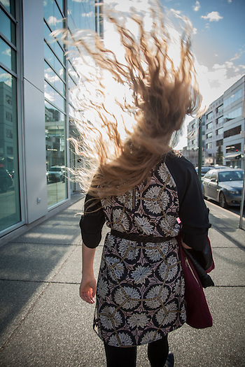 Holly Furman tosses her hair in the wind as she walks down Fourth Avenue during the First Friday Art Walk in downtown Anchorage. (© Clark James Mishler)