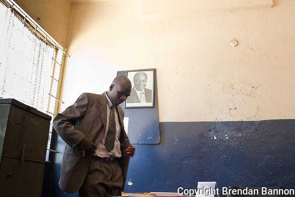 Corpal Patrick Simiyu, a detective  in Nairobi's anti-fraud and forensics investistigation unit. Simiyu investigates cases of fraud and electronic fraud. (Photographer: Brendan Bannon)