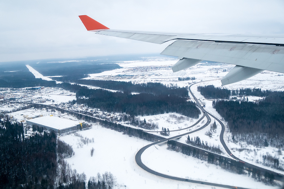 View from an airplane window landing in Moscow during winter time with snow in the ground. (Daniel Korzeniewski)