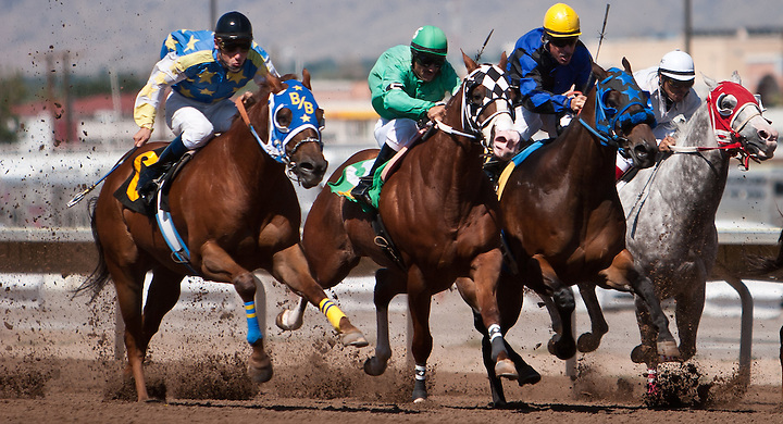 "© Steven St. John / The Communicator..Jude Baca, left, pushes his horse ""He's A Slinky"" past the competition during his race The Downs at Albuquerque on Friday, Sept. 2, 2011..... (Steven St. John)"