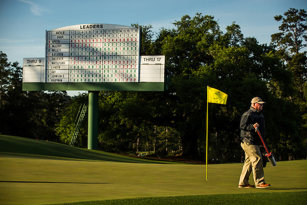A member of the grounds staff leaves the 18th green after cutting the hole prior to the final round of the 2016 Masters Tournament. Golf: 2016 Masters Round 4 Sunday Augusta National/Augusta, GA, USA 04/10/2016 SI-14 TK4 Credit: Darren CarrollGolf: 2016 Masters Round 4 Sunday Augusta National/Augusta, GA, USA 04/10/2016 SI-14 TK4 Credit: Darren Carroll (Darren Carroll/Sports Illustrated)