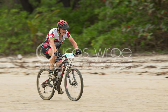 Competitors ride into the finish, June 1, 2014 - MOUNTAIN BIKE : RRR Mountain Bike Challenge, Cairns Airport Adventure Festival, Four Mile Beach, Port Douglas, Queensland, Australia. Credit: Lucas Wroe (Lucas Wroe)