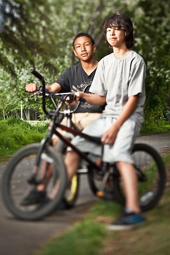 East High School 9th graders, Dahrnelle Keller and Evan Kosbruk, on the bike trail near Valley of the Moon Park, Anchorage (Clark James Mishler)