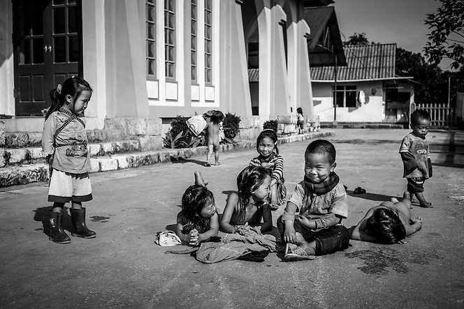 Ethnic minority children play and sunbathe in on the grounds of a church just outside Sapa, Vietnam. (Quinn Ryan Mattingly)
