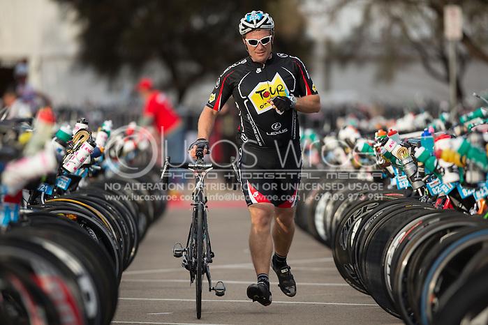 Age Group Competitors Transition Swim To Bike, March 23, 2014 - Ironman Triathlon : Swim Course. Ironman Melbourne Race Race, Frankston Transition, Melbourne, Victoria, Australia. Credit: Lucas Wroe (Lucas Wroe)