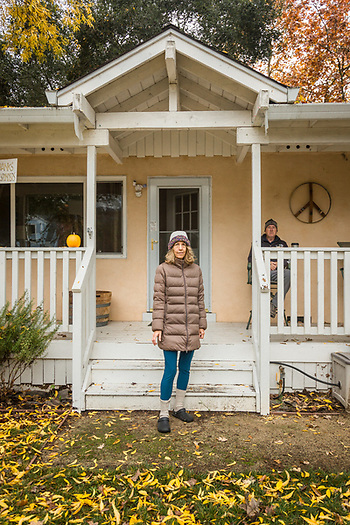 Jennifer Norris stands in front of her home as her husband, Matt Sarconi, watches from their porch on Myrtle Street in Calistoga.  anniegal2000@yahoo.com (Clark James Mishler)