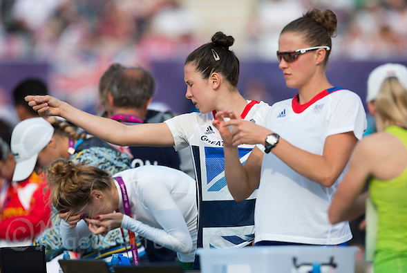 12 AUG 2012 - LONDON, GBR - Adrienn Toth (left) of Hungary, Samantha Murray (GBR) (centre) of Great Britain and Amelie Caze (right) of France prepare before the start of the women's London 2012 Olympic Games Modern Pentathlon Combined Event in Greenwich Park, Greenwich, London, Great Britain .(PHOTO (C) 2012 NIGEL FARROW) (NIGEL FARROW/(C) 2012 NIGEL FARROW)