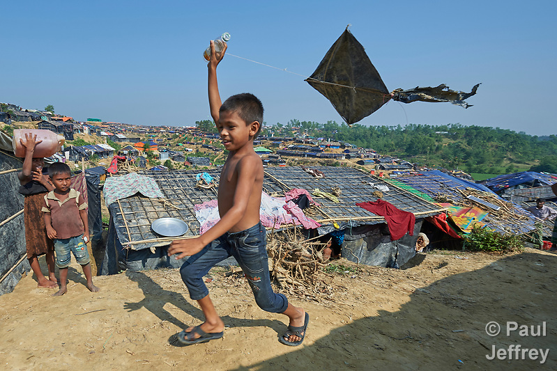 A Rohingya boy flies a kite in the Jamtoli Refugee Camp near Cox's Bazar, Bangladesh, where members of the ACT Alliance provide humanitarian support for the refugees. More than 600,000 Rohingya have fled government-sanctioned violence in Myanmar for safety in Bangladesh. (Paul Jeffrey)