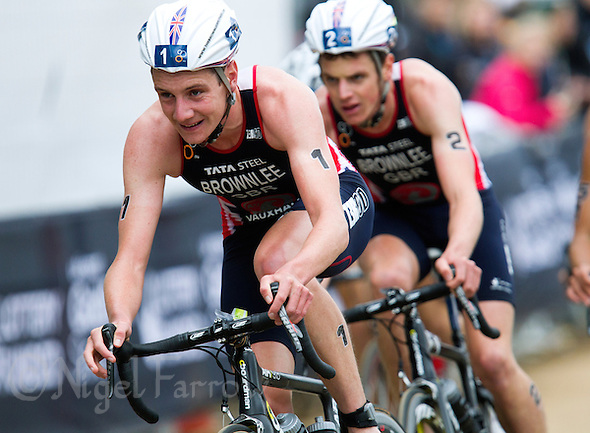 15 SEP 2013 - LONDON, GBR - Alistair Brownlee (GBR) (left) of Great Britain leads his brother Jonathan Brownlee (GBR) (right) also of Great Britain during the bike at the elite men's ITU 2013 World Triathlon Series Grand Final in Hyde Park, London, Great Britain (PHOTO COPYRIGHT © 2013 NIGEL FARROW, ALL RIGHTS RESERVED) (NIGEL FARROW/COPYRIGHT © 2013 NIGEL FARROW : www.nigelfarrow.com)