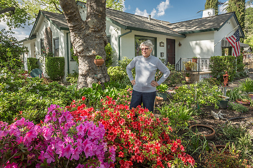 """I was born in this house and the only way I'm leaving is with a toe tag!""  -Sonya Spencer takes a break from gardening in front of her house on Lake Street in Calistoga. (Clark James Mishler)"
