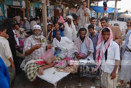 LAHIJ, YEMEN - SEPTEMBER 15, 2006: Men sell khat (Catha edulis) at the local market in Lahij, Yemen. Chewing khat (drug of abuse) is a major social problem in Yemen. (Dmitry Chulov)