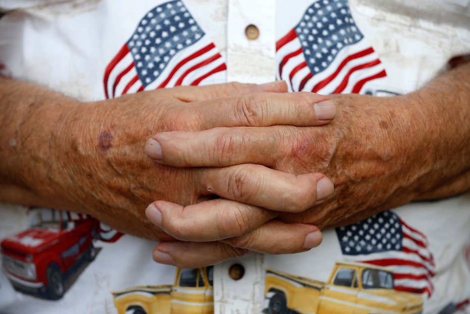 Arnold Damman's clasped hands, gnarled from a lifetime of farm labor. (Christopher Gannon/The Register)
