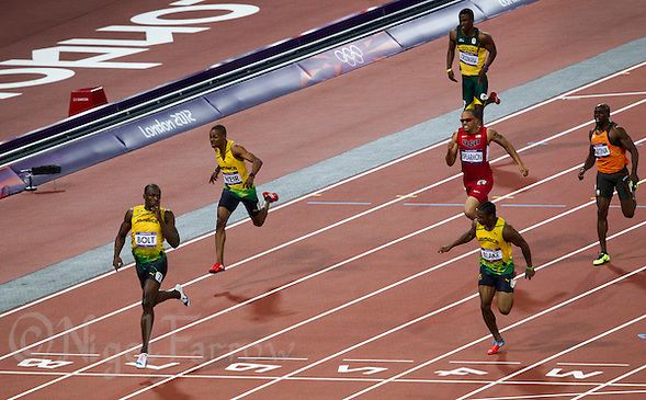 09 AUG 2012 - LONDON, GBR - Usain Bolt (JAM) (left) of Jamaica celebrates winning the men's 200m final ahead of Jamaican team mates Warren Weir (JAM) (second from the left) and Yohan Blake (JAM) (second from the right) at the London 2012 Olympic Games athletics in the Olympic Stadium in Stratford, London, Great Britain .(PHOTO (C) 2012 NIGEL FARROW) (NIGEL FARROW/(C) 2012 NIGEL FARROW)