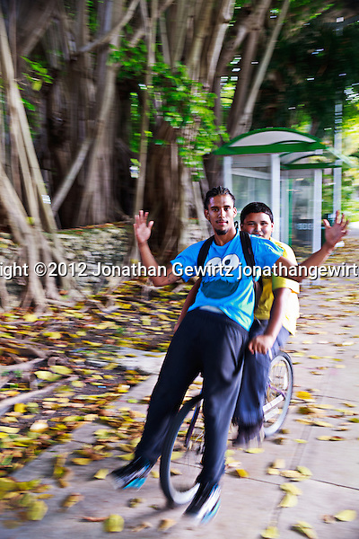 Two young men on a bicycle in Miami, Florida. (© 2012 Jonathan Gewirtz / jonathan@gewirtz.net)