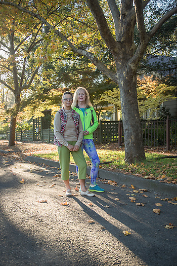 Sisters-in-law and close friends Liz Farnell of West Yorkshire, England, and Mary Takacs of Calistoga out for a morning walk on Cedar Street. (Clark James Mishler)