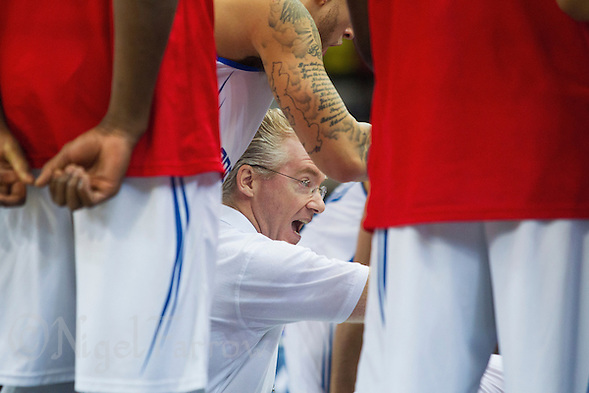 20 AUG 2014 - LONDON, GBR - Great Britain Head Coach Joe Prunty (GBR) gives a team talk during the men's 2015 EuroBasket 3rd Qualifying Round game in the Copper Box Arena in the Queen Elizabeth Olympic Park in Stratford, London, Great Britain (PHOTO COPYRIGHT © 2014 NIGEL FARROW, ALL RIGHTS RESERVED) (NIGEL FARROW/COPYRIGHT © 2014 NIGEL FARROW : www.nigelfarrow.com)