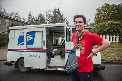 Charlie, our ever cheerful ex-skateboarder postal carrier, on a wet morning in Calistoga (Clark James Mishler)