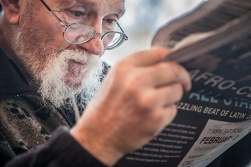 Bob, reading his newspaper at Vagabon Blues, Palmer, Alaska (Clark James Mishler)