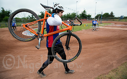 14 JUN 2015 - IPSWICH, GBR - Having been excluded from an earlier heat after being deemed to have brought down another rider Josh Brooke of Ipswich Eagles walks to the start grid for a heat during the Elite League cycle speedway fixture against Poole Comets at Whitton Sports and Community Centre in Ipswich, Suffolk, Great Britain (PHOTO COPYRIGHT © 2015 NIGEL FARROW, ALL RIGHTS RESERVED) (NIGEL FARROW/COPYRIGHT © 2015 NIGEL FARROW : www.nigelfarrow.com)