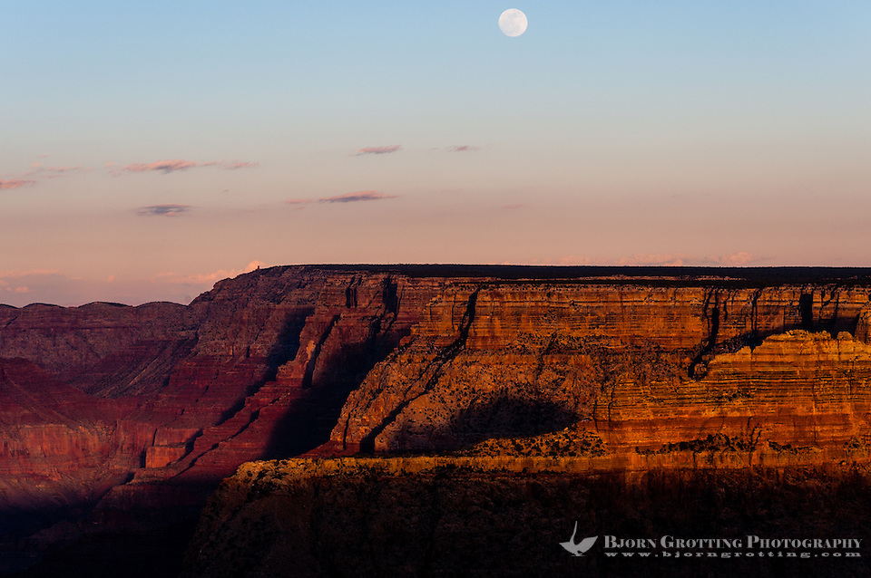 United States, Arizona, Grand Canyon. Sunset at Lipan Point, with a full moon hanging above Grand Canyon. (Photo Bjorn Grotting)