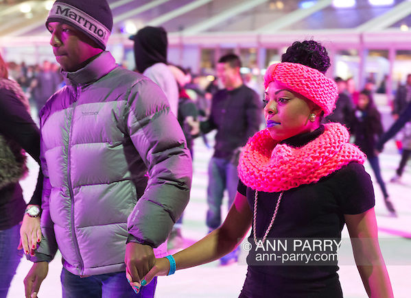 At Bryant Park's ice skating rink that night, the colorful rink is filled with people skating and talking with friends. Manhattan, New York, USA. November 9, 2013. (Ann Parry/Ann Parry, ann-parry.com)