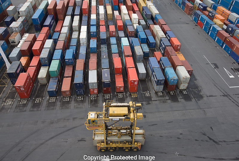 Straddle cranes work  loading ships on the Ports of Auckland    , North Island ,New Zealand   , New Zealand  on Sept 5th  2014   Photograph by Brendon O'Hagan /Bloomberg News (Brendon O'Hagan)