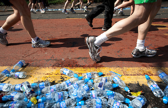 17 APR 2011 - LONDON, GBR - Runners pass empty water bottles during the London Marathon (PHOTO (C) NIGEL FARROW) (NIGEL FARROW/(C) 2011 NIGEL FARROW)