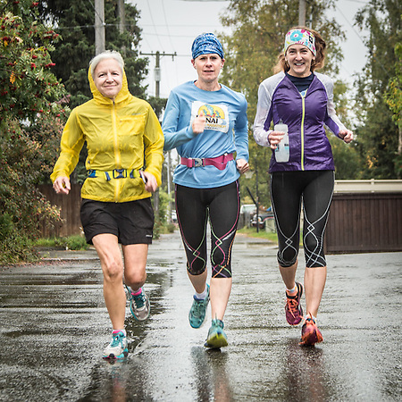 Distant runners Patrice Parker, Sarah Kleedehn and Cindy Hendel on a raining afternoon in Anchorage's South Addition (© Clark James Mishler)