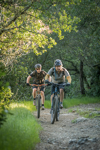 Electronic technition Sean Watkins and Brewer, E.J. Coudert, ride their mountain bikes on Oak Hill Mine Trail, Calistoga (Clark James Mishler)