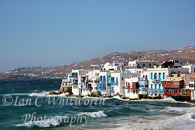 Looking across the waves at Little Venice at Mykonos in Greece (Ian C Whitworth)