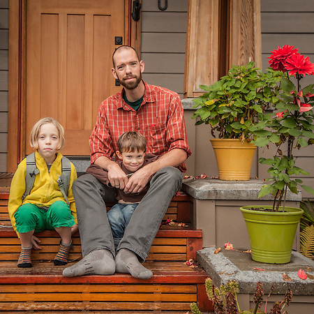 Neighbor Andrew Cutting with his daughter Ellie and son Ezra on their front porch in Anchorage's South Addition neighborhood (© Clark James Mishler)