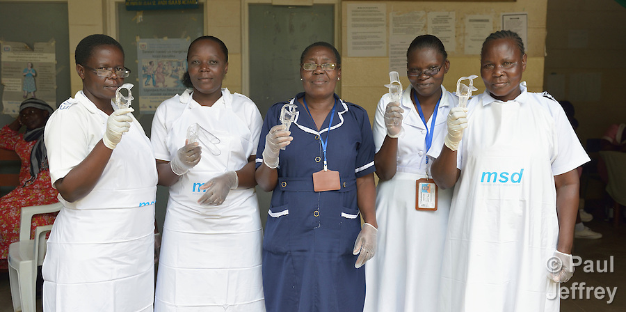 The nurses who do cervical cancer screening in the Shirati Hospital in Shirati, Tanzania. From left to right, they are Elizabeth Peter, Joyce Agutu, Moureen Mbise, Grace Adebi and Sophia Nyosingo. (Paul Jeffrey)