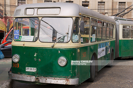 VALPARAISO, CHILE - OCTOBER 19, 2013: Unidentified man enters old trolleybus in Valparaiso, Chile. Old trolleybus system from 1950's is one of the icons of Valparaiso city. (Dmitry Chulov)