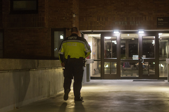 4/14/16—Medford/Somerville—A TUPD officer patrols Wren Hall on the night of April 14, 2016, following an assault incident that occurred in the dorm earlier this month. (Max Lalanne/The Tufts Daily) (Max Lalanne/The Tufts Daily)