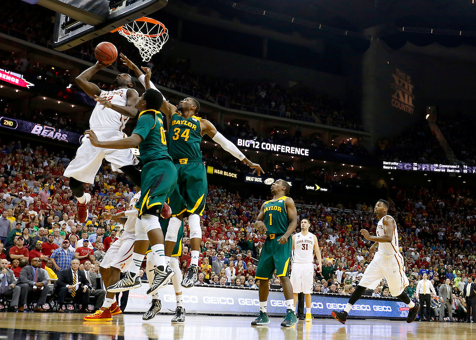 Iowa State's Dustin Hougue (22) scores around Baylor's Royce O'Neale and Cory Jefferson (34) during the Big 12 championship game Saturday, March 15, 2014 in Kansas City, Mo. (Christopher Gannon/The Register)