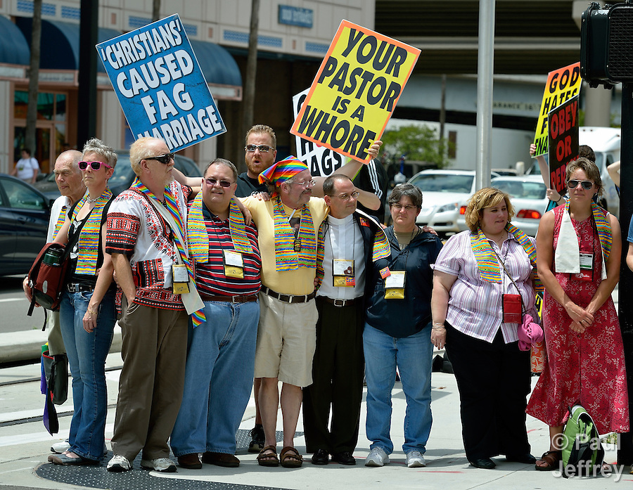 United Methodist activists form a human shield to block a demonstrator from the Westboro Baptist Church on May 4 outside the 2012 United Methodist General Conference in Tampa, Florida. The United Methodists belong to a group that supports the full inclusion of gays and lesbians in the life of the church, while the Westboro demonstrators travel widely with their anti-homosexual agenda.