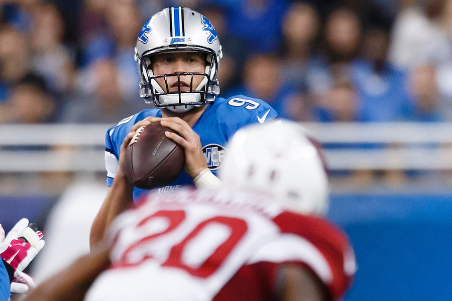 Detroit Lions quarterback Matthew Stafford (9) looks to pass against the Arizona Cardinals during an NFL football game at Ford Field in Detroit, Sunday, Oct. 11, 2015. (AP Photo/Rick Osentoski) (Rick Osentoski/AP)