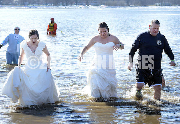 From left, Amber Kenney, Karli Krug and Adam Bockius exit the 32 degree Delaware River during the eighth annual Eastern Polar Bear Plunge to benefit Special Olympics Pennsylvania (SOPA) Saturday January 30, 2016 at Neshaminy State Park in Bensalem, Pennsylvania. (Photo by William Thomas Cain) (William Thomas Cain/Cain Images)