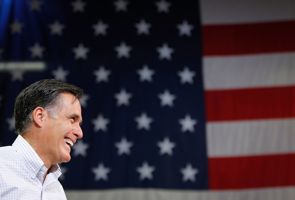 Presidential hopeful Mitt Romney smiles during a town hall meeting to discuss jobs and the economy in Cedar Rapids on December 9. (Christopher Gannon)