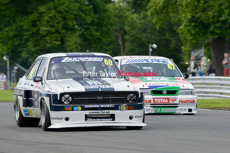 #60 Mark Wright - Ford Escort in front of #67 Tony Absolom - Vauxhall Cavalier during HSCC Super Touring Car Championship race two at Oulton Park, Little Budworth, Cheshire, United Kingdom. June 08 2014. World Copyright Peter Taylor/PSP. Copy of publication required for printed pictures. Every used picture is fee-liable. http://archive.petertaylor-photographic.co.uk (Peter Taylor/PSP)