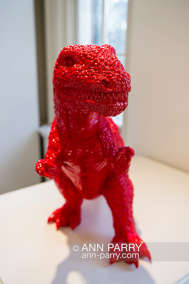 "Roslyn, New York, USA. January 2, 2015. Dinosaur (2006) in red polyresin, by Chinese artist Sui Jianguo (b. 1956) is displayed at the Nassau County Museum of Art China Now and Then Exhibit. ""MADE IN CHINA"" is written in big block letters down his chest. (Ann Parry/Ann Parry, ann-parry.com)"