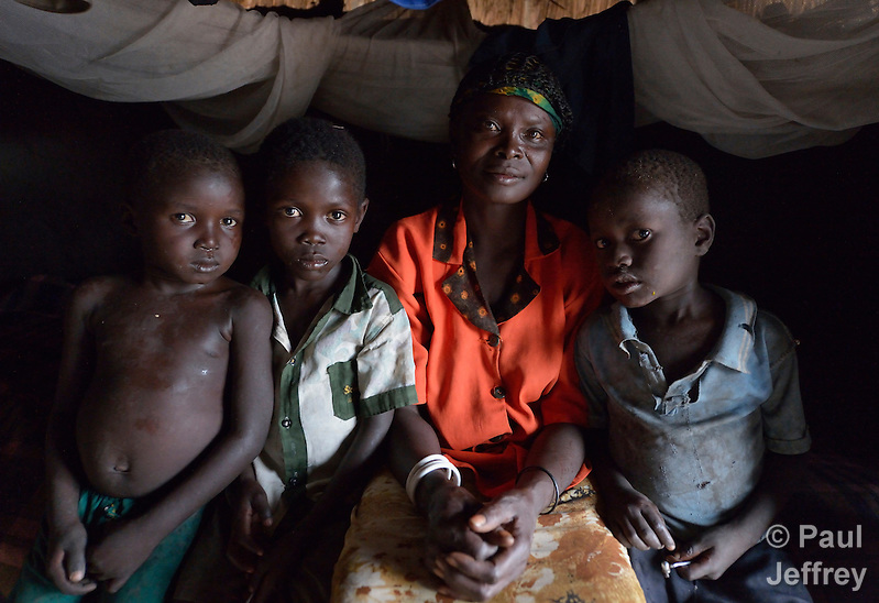 Asanta Jantana sits in a earthen-walled house in Kotobi, South Sudan, along with three of her children. They are among hundreds of thousands of people who were displaced by political violence that broke out in December 2013 and quickly fractured regions of the young nation along ethnic and tribal lines. Jantana fled Juba with her seven children for this village, where she moved in with a brother. Yet she hasn't had enough food for her whole family, so she sent four of her children to live with another relative. She hasn't heard from her husband, a soldier, since the fighting began. Finn Church Aid, a member of the ACT Alliance, provided materials for distribution of food and non-food items that benefited Jantana and other displaced people here. (Paul Jeffrey)