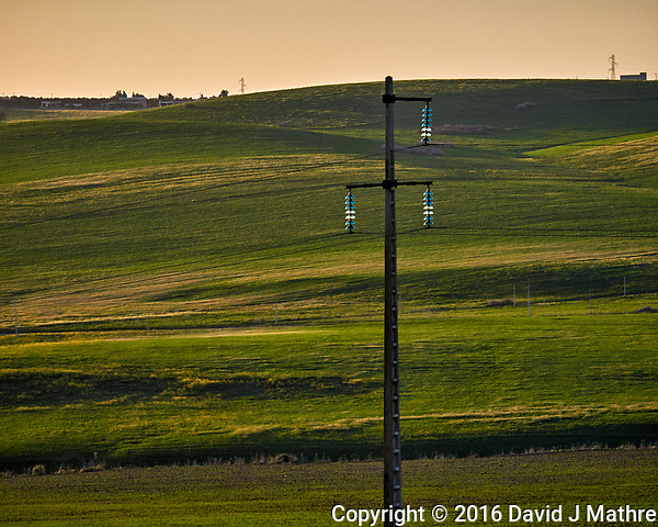 Interesting Glass Insulators Holding the Power Lines. Early evening on a bus traveling on the highway from Fes to Casablanca, Morocco. Image taken with a Fuji X-T1 camera and 55-200 mm OS lens (ISO 400, 116 mm, f/4.2, 1/1000 sec). (David J Mathre)