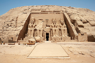 "The Abu Simbel temples are two massive rock temples in Abu Simbel  in Nubia, southern Egypt. They are situated on the western bank of Lake Nasser, about 230 km southwest of Aswan. The complex is part of the UNESCO World Heritage Site known as the ""Nubian Monuments"" which run from Abu Simbel downriver to Philae (near Aswan). (unknown)"
