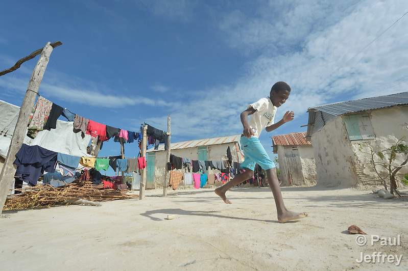 A boy plays hopscotch in the Haitian community of Ganthier, where Servicio Social de las Iglesis Dominicanas, a member of the ACT Alliance, has built hundreds of homes and helped families rebuild the local economy during the first year after the devastating passage of Hurricane Matthew in 2016. (Paul Jeffrey)